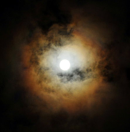 """""""Moon Halo"""".  Full moon with cloud coverage producing a colorful halo. 4/8/09"""