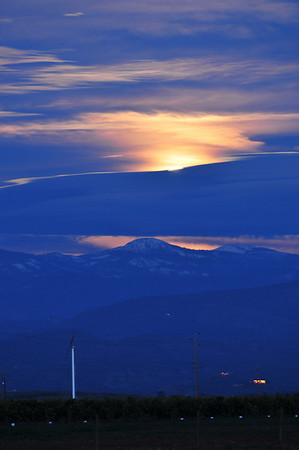 """A special New Year's Eve """"blue moon"""" rises over the Sierra Nevada Mt's. A """"blue moon"""" is when a second """"full moon"""" rises in a calendar month.  The next """"blue moon"""" that will appear on New Year's Eve will be in 19 years!  5:21 PM, 12/31/09."""