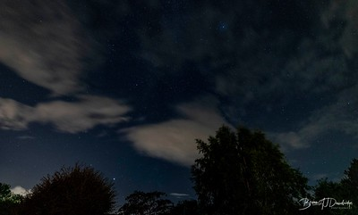 Night sky viewed through passing clouds