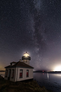 Milky Way over Lime Kiln lighthouse last night. Lots of light pollution from Victoria (right) and Port Angeles (left) - but it turned out better than I feared.