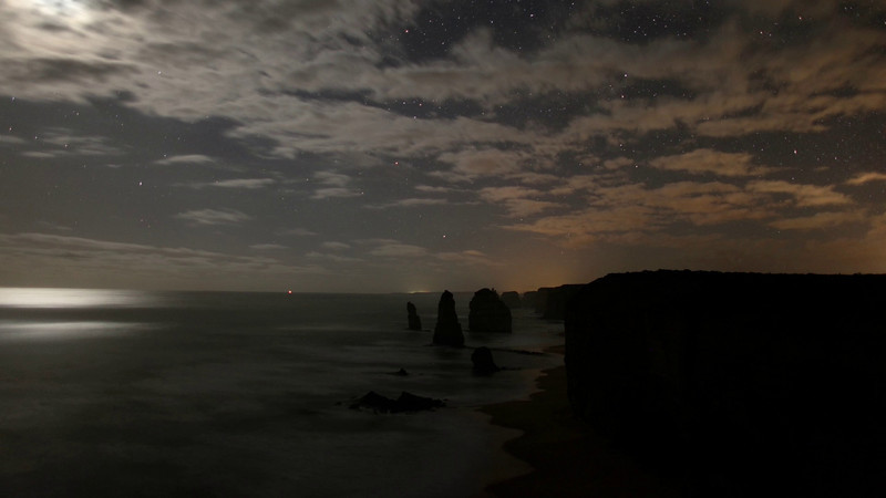 Clouds and stars over the Twelve Apostles in Port Campbell National Park, Victoria.