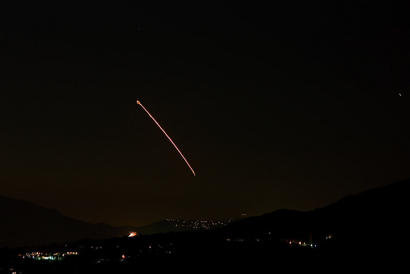 Launch of a Delta II rocket from Vandenberg AFB, with Italy's COSMO-3 radar imaging satellite. Distance is about 140 miles.<br /> Lights in the lower right corner are Jet Propulsion Laboratory, city lights in the center are La Crescenta.<br /> <br /> Taken from the side of Echo Mountain in Altadena, CA on 10/24/2008<br /> Canon XSi with 24-105L IS lens @ 105mm<br /> 30 sec exposure, ISO 200, f/5.6<br /> <br /> The squiggles at the beginning and end are because I did not use mirror lockup. I had pre-set the camera with mirror lockup and remote release, but somehow managed to undo the settings while I waited impatiently for launch. Sigh...
