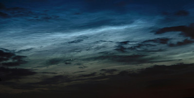 Stunning noctilucent display from 14 July 2009 Leics, UK. This was such an intense display and so early compared to previous sightings, 10.30pm. There was lots of cloud cover too but such was the intensity of the electric blues that it made hardly any difference! A good contrast here of clouds in the lower part of the atmosphere (Troposphere up to 14km or 8 miles high) compared with the noctilucent in the upper part (Mesosphere up to 90km or 55 miles high). Taken with Olympus E3 & 12-60mm SWD