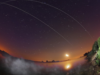 Double ISS flyby over misty water