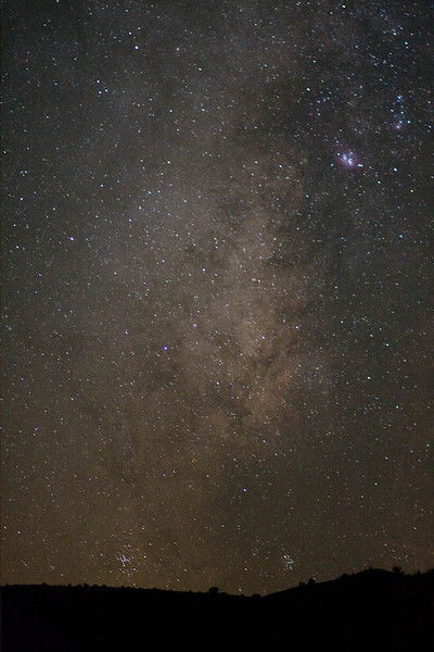 At the bottom of this photo are two globular star clusters: the M7 Ptolemy Cluster on the left and the M6 Butterfly Cluster on the right.  Near the upper right corner you see a couple of nebulae: the M8 Lagoon Nebula and M20 Trifid Nebula.  Roughly halfway between the globular clusters at the bottom and the nebulae at the top lies the central bulge of our Milky Way Galaxy.