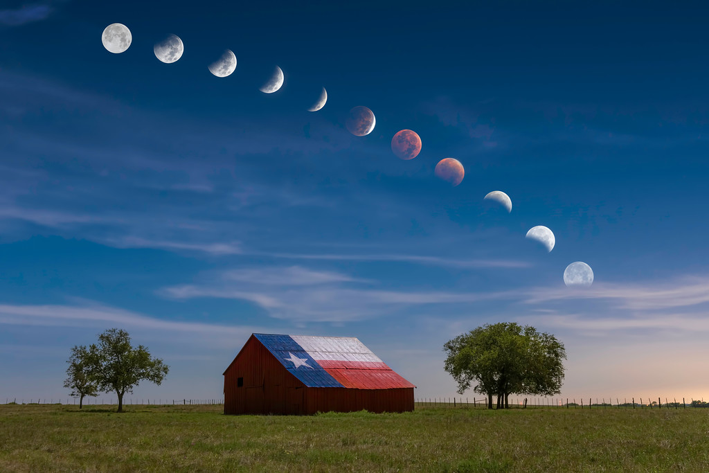 "The transition of the lunar eclipse, also known as ""blood moon,"" of October 8, 2014, over a barn in rural central Texas."