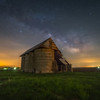 Starry night over an old farm building on the Illinois countryside
