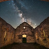 The night sky as seen through the missing roof of a 160 year old abandoned stone church in northern Iowa