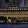 "The Fullerton Hotel with Merlion in foreground and ""Wishing Spheres"" floating on bay"