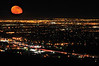 This shot was achieved by stacking one moon shot <br /> with ONE perfectly exposed city lights shot.