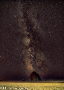 Haystack Rock with the Milky Way behind it