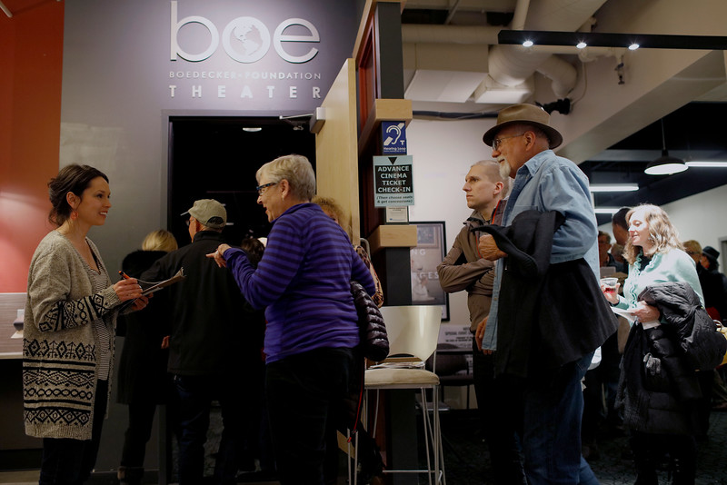 Rachael Trinklein, left, checks in guests arriving for a night of comedy at the Boedecker Theatre in The Dairy Arts Center on Saturday, Apr. 16, 2016 in Boulder. (Photo by Trevor Davis)