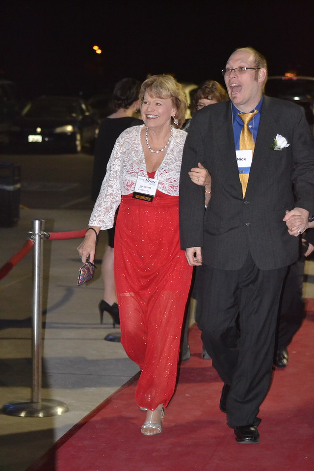Nick, a guest at the Night to Shine event, sponsored by the Tim Tebow Foundation, at Vineyard Christian Church, is escorted by his friend, Connie Mueller, walk the red carpet on Friday. Carie Canterbury/Daily Record 2-12-16