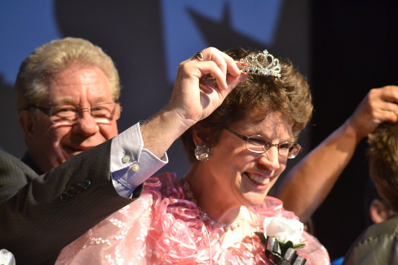 Rebecca S. is presented with a tiara by her friend, Terry Hamilton, during the Night to Shine event, sponsored by the Tim Tebow Foundation, in the ballroom set up at Vineyard Christian Church on Friday. Carie Canterbury/Daily Record 2-12-16