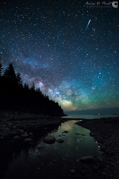 An incredibly bright meteor streaks over the Milky Way as it reflects in Hunter's Brook at Hunter's Beach in Acadia National Park on May 20, 2015, 11:07 PM.<br /> <br /> Nikon D700 & 14-24mm f/2.8 @ 14mm, f/2.8, ISO 6400, 20 seconds, 3429°K white balance