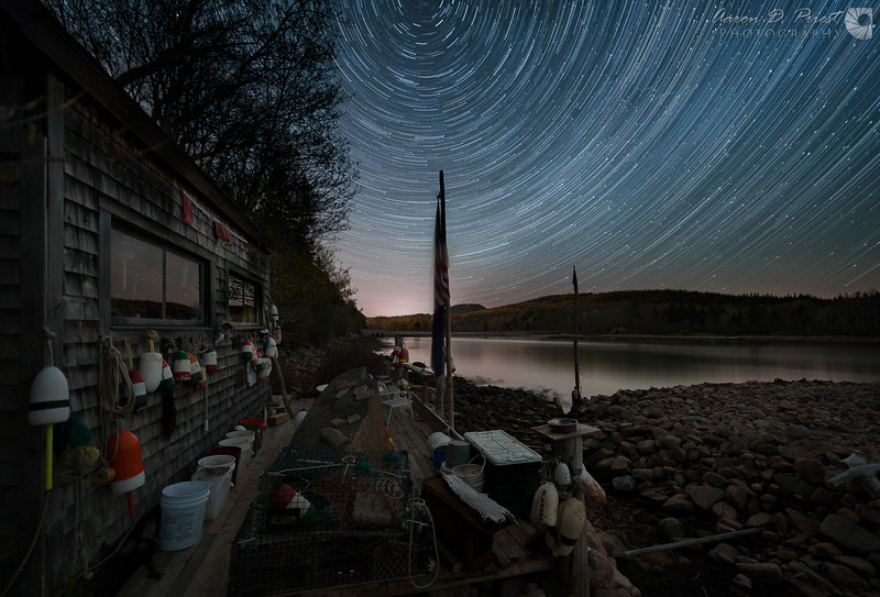 Star trails over fishing shack