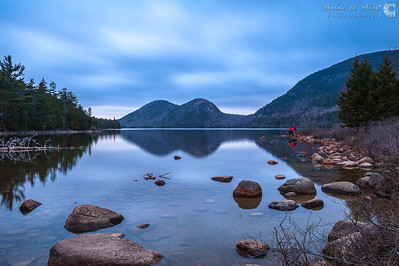 Vincent Lawrence and Joe Meirose photograph The Bubbles reflecting in Jordan Pond after sunset.