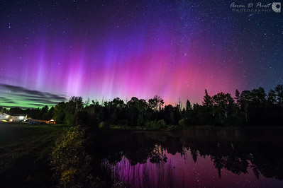 Aurora borealis over my back yard pond in Lee, Maine