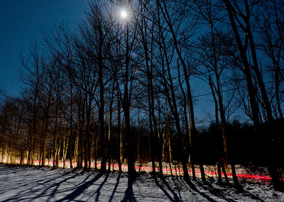 Moon light with snow and car lights