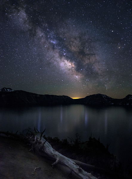 The milky way glows over Crater Lake thanks to extremely dark skies with little light pollution