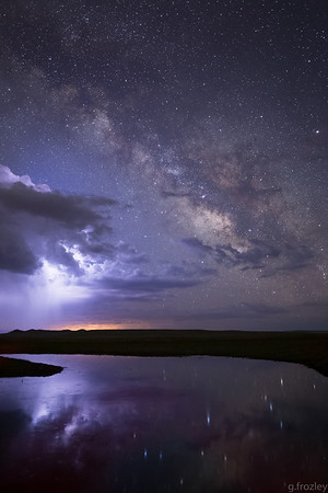 Lucked out with the lightning lighting up the clouds during this Milky Way exposure.   Middle Fork South Platte River, South Park, CO.
