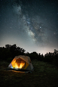 The Milky Way arches over the tent at 3:30 AM while Emmett sleeps during a weekend camping trip near Canon City, CO.