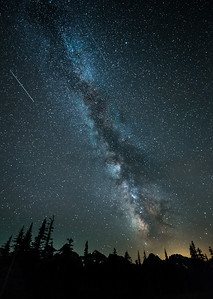 Meteors streak through the sky near Mt Rainier National Park