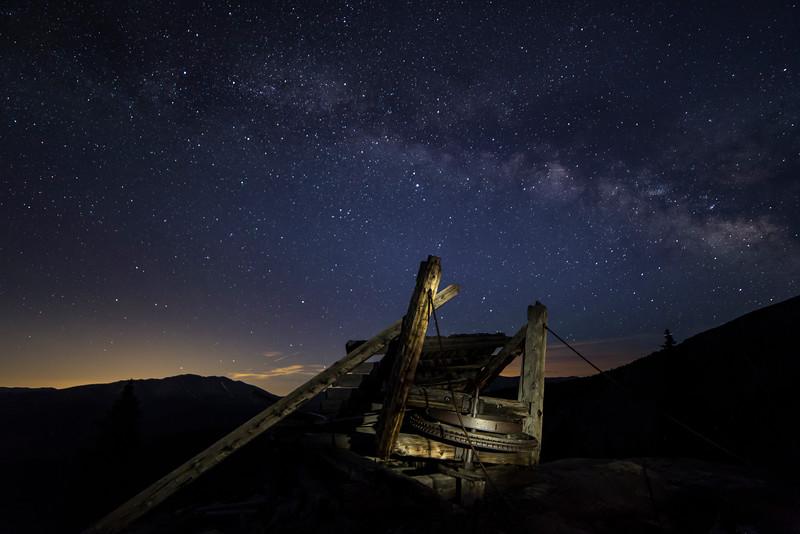 Bull wheel left from the mining days in Breckenridge.   Thanks for the background lights, Denver!