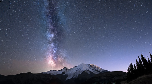 Galactic core of the Milky Way, as evidenced by the Dark Horse Galaxy just above Little Tahoma