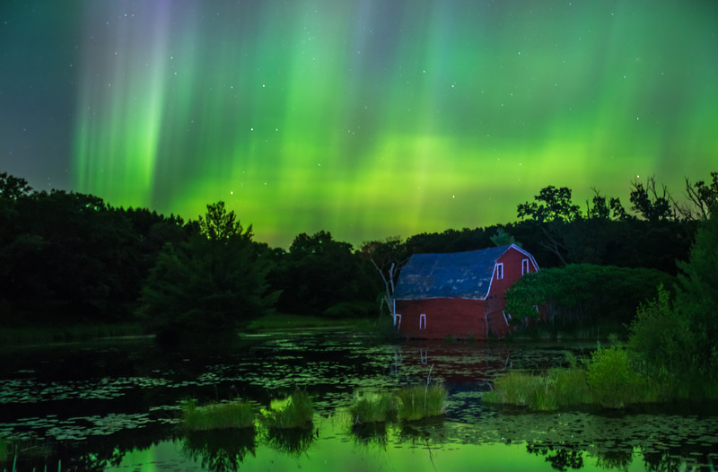 Auroras over Red Barn in wetland