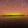 Aurora borealis and star trails