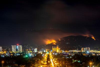 Apocalyptic view over Rockhampton as the mountain range burns.
