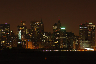 Lady Liberty with Manhattan behind her.
