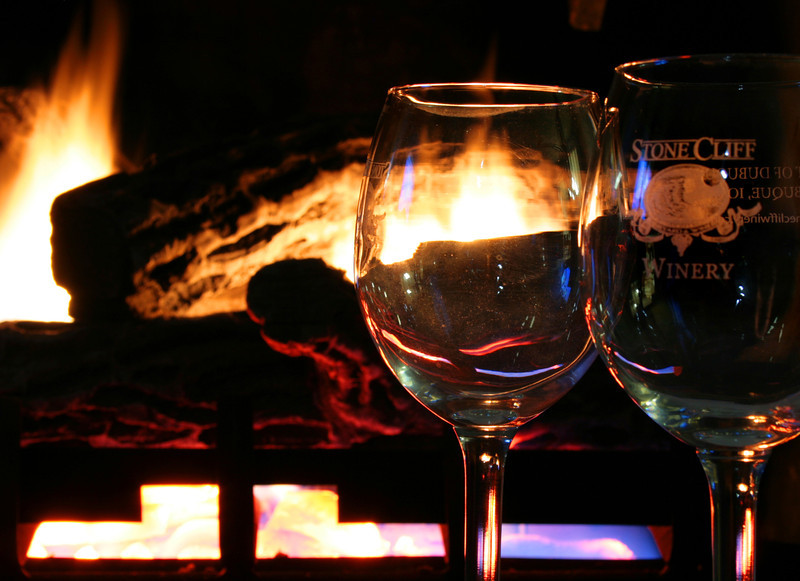 Stone Cliff Winery glasses fireside.