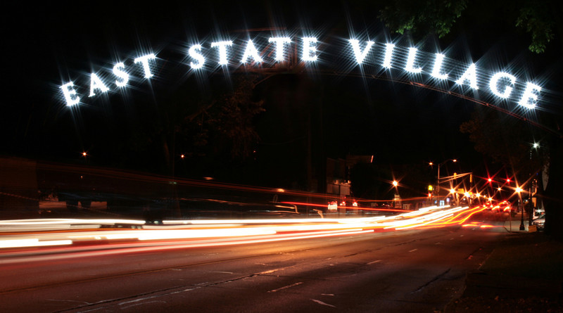 East State sign lit up at night.