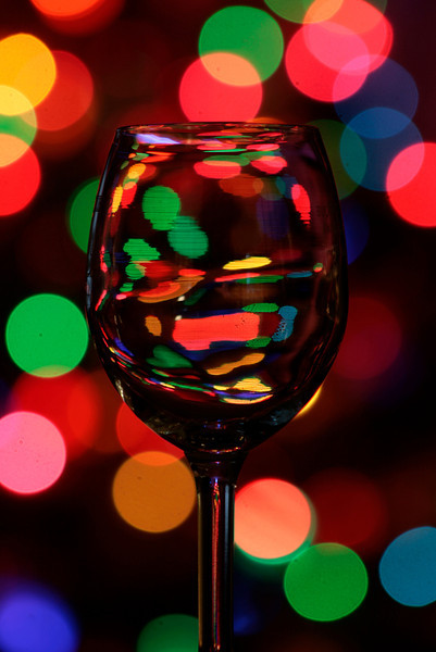 New Years Eve wine glass in the glow of the Christmas Tree.