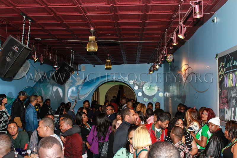 Ivy League host their annual Mardi Gras Event Masq and Beads at Lola. Photography by NightSociety.