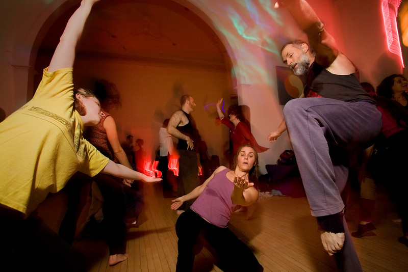 1/9/09 Brookline, MA -- ADVANCE for Boston.com.  Madeleine Pluhar (center) of Woburn does some improvisational dancing with Mark Zagaeski (right) of Lexington during Dance Friday at the Brookline Tai Chi Center January 9, 2009.  Dance Friday is a volunteer-run, non-profit dance organization which began in 1979. Many of it's original members are still dancing today.  On any given Friday night, you'll find dancers of all ages, some dancing barefoot, some with a partner, some without, moving to the sounds of community DJ's playing a mix of contemporary, world music, pop, hip hop, reggae, classic rock, disco, funk, ska, latin, swing, R&B, and blues music.  Erik Jacobs for the Boston Globe