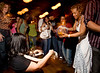 2/15/08 Boston, MA -- Ife Franklin plays a west African shaker while Janet Gonzalez perfroms the Bomba, an African folkloric dance of Puerto Rico at Bembe, an Afro-Latin dance celebration at The Red Fez in Boston February 15, 2008.  Erik Jacobs for the Boston Globe