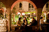 2/21/08 Boston, MA -- From left, Nao Murakami (originally from Japan), Magdalena Fossum (from Sweden) and Bara Zuhaili (originally from Syria) talk in an archway at Gardner After Hours event at the Isabella Stewart Gardner Museum February 21, 2008.  Erik Jacobs for the Boston Globe