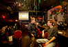 3/11/08 Cambridge, MA -- With the video screen behind them, Josh Read and Adam Blanchette (left to right) wait their turn on the Wii at Wii night at River Gods in Cambridge March 11, 2008.  Erik Jacobs for the Boston Globe