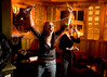 3/11/08 Cambridge, MA -- Erin Pelletier triumphantly raises her hands after a Wii boxing victory over her friend Megan Coogan at Wii night at River Gods in Cambridge March 11, 2008.  Erik Jacobs for the Boston Globe