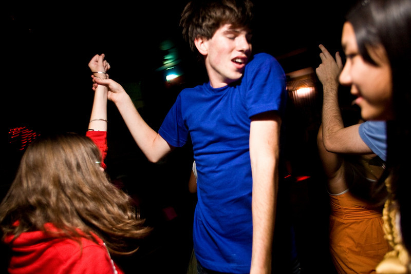 8/9/08 Brookline, MA --  Birthday boy Jon Buckley, 17, danced with friend Kelsey Warren, who both drove down from New Hampshire to celebrate Buckley's birthday at the Madonna Sing-along at the Coolidge Corner Theatre in Brookline, MA August 9, 2008.  Erik Jacobs for the Boston Globe