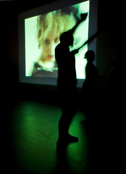 8/9/08 Brookline, MA -- With Madonna herself peering out of the movie screen dancers move to the sounds of the Madonna Sing-along at the Coolidge Corner Theatre in Brookline, MA August 9, 2008.  Erik Jacobs for the Boston Globe