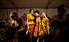 "5/7/11 Boston, MA -- A center, from left, Christina Hernandez, Jeanily Cruz and Gina Russell model Gillian Wright's Cuban-influenced collection entitled ""Las Mujeres"" backstage at Voltage 2011, Massachusetts College of Art and Design senior fashion show May 7, 2011.  Erik Jacobs for the Boston Globe"