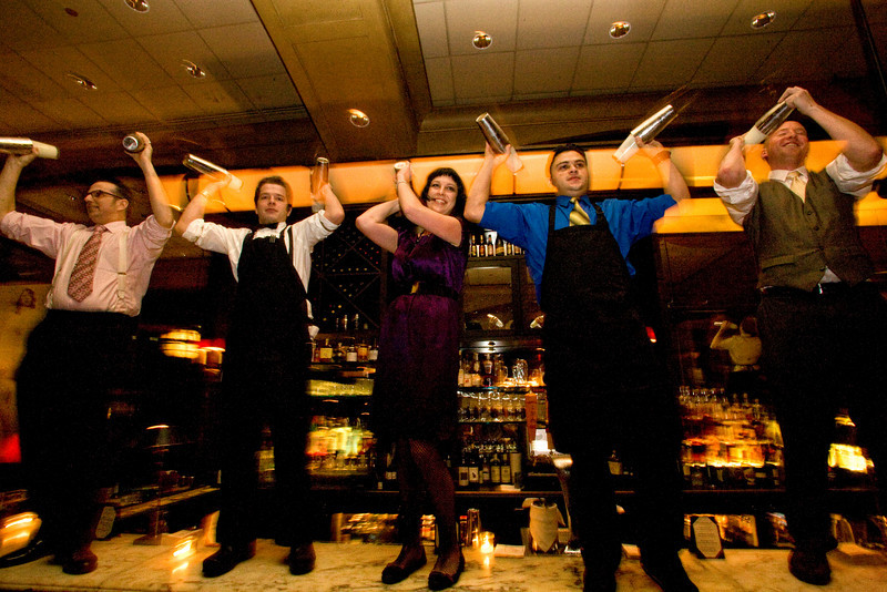 12/4/08 Boston, MA -- Bartenders stand on the bar to mix drinks in celebration of the 75th Anniversary of the Repeal of Prohibition at the roaring 20's party at Eastern Standard in Boston December 4, 2008.  Erik Jacobs for the Boston Globe