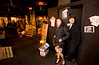 """12/4/08 Boston, MA -- Bill Hendriksen of Brighton and Lauren Saia of Boston exit the roaring 20's party through the private door at the """"Speakeasy"""" formerly known as Eastern Standard in Boston December 4, 2008.  Erik Jacobs for the Boston Globe"""
