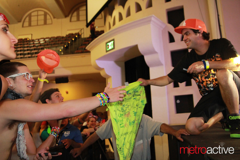 Datsik signing some autographs @ Sunrise 2013.  Images by: CJ