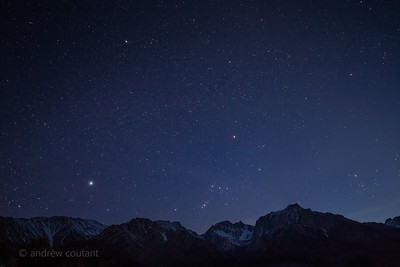 Sunset as the constellation Orion sets over the eastern Sierra and Mt Whitney