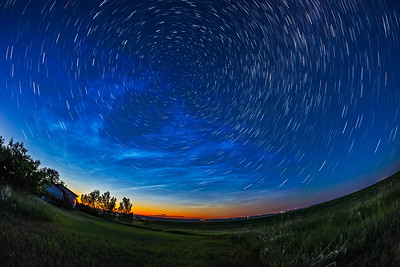 Circumpolar Star Trails with Noctilucent Clouds